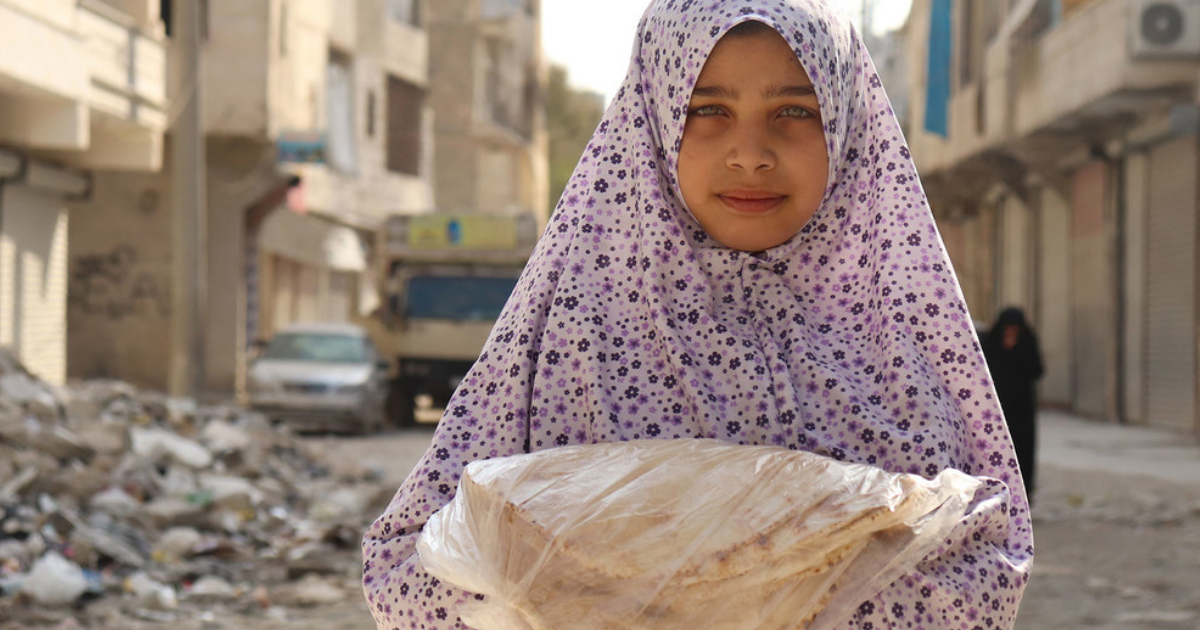 PMA_Khudr Alissa PMA distribui alimentos em Aleppo, na Síria