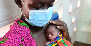 Soro Sali, 39, at the regional hospital of Korhogo, Côte d'Ivoire. Soro's sister-in-law died giving birth to triplets, so she and her three sisters are taking care of the 10-day-old babies. Photograph_ Frank Dejong