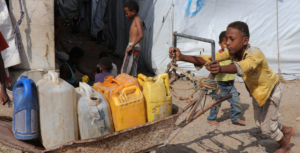 © UNICEF A 13-year-old boy collects water in Ammar Bin Yasser, a camp for people displaced by the conflict in Yemen.